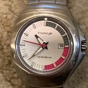 Freestyle Stainless Date Screwback Case WR Watch.